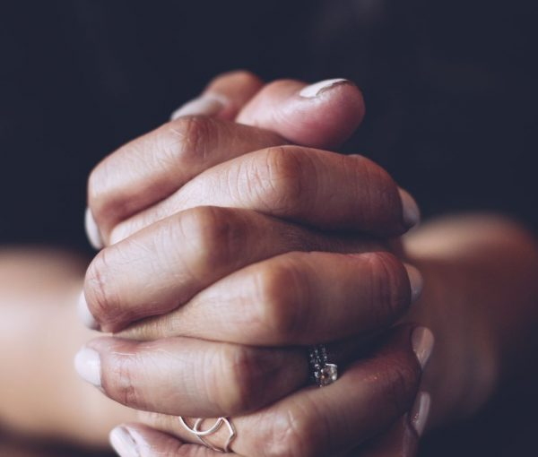 woman-with-clasped-hands-royalty-free-image-720015757-1542648168